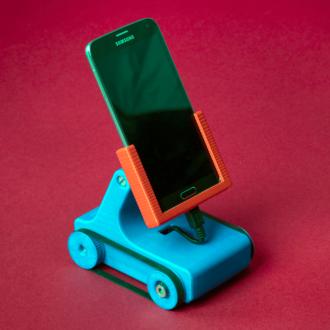 Plastic karretje met smartphone erop