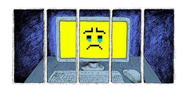 Computer achter de tralies met een verdrietige smiley op het scherm