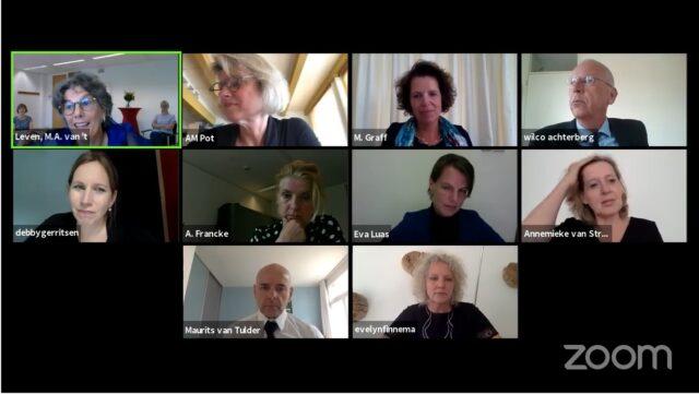 het zoom-scherm met de commissie en Netta
